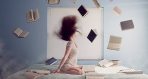 woman-trowing-books